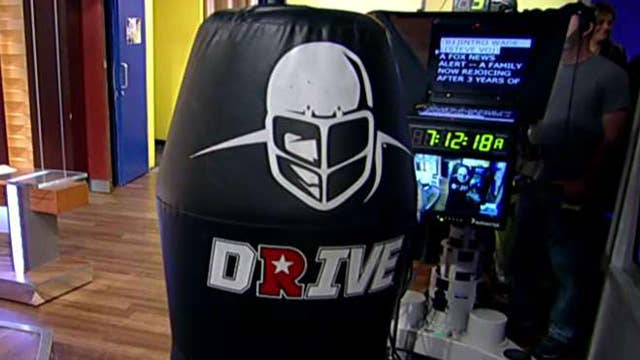 Football gets high tech with robotic tackling dummy
