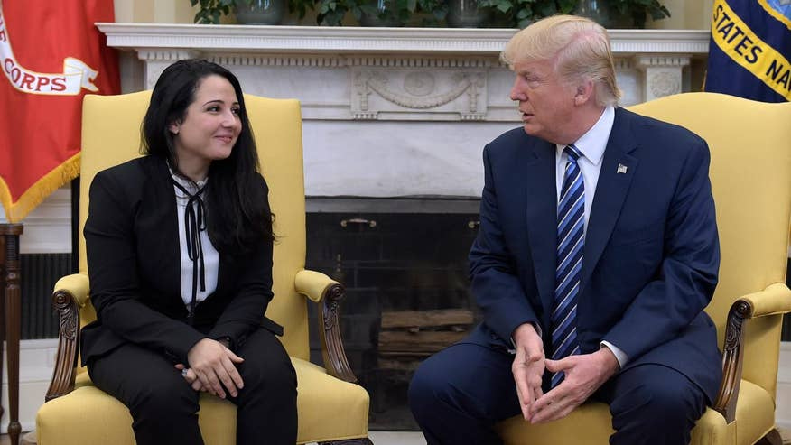 photo image Trump meets with Egyptian aid worker released from Cairo jail