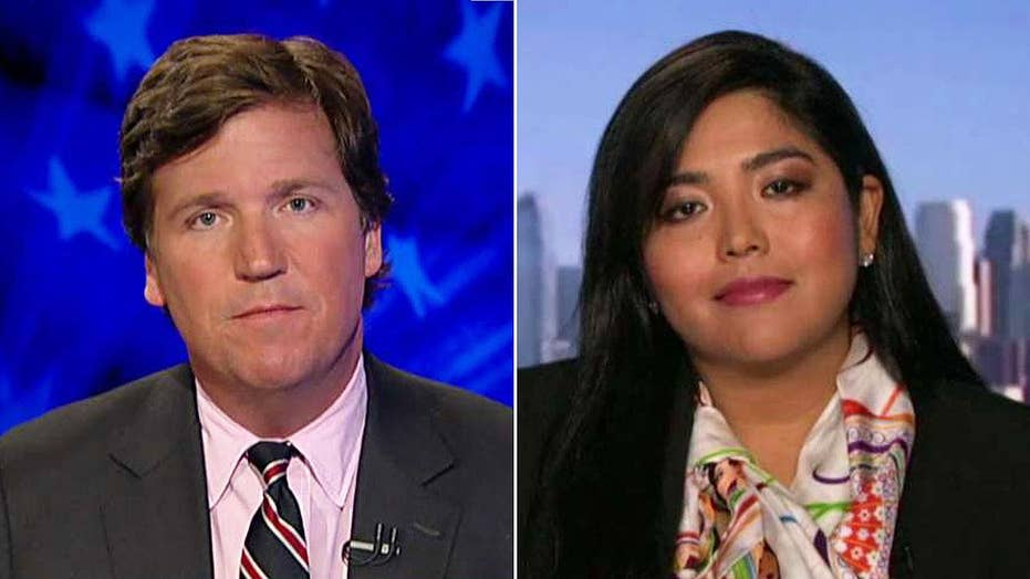 Tucker to author: Why's Trump's wall a symbol of hate?