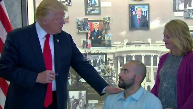 Trump visits Walter Reed hospital to award Purple Heart