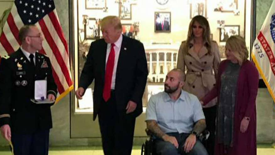 President makes first visit to Walter Reed Hospital