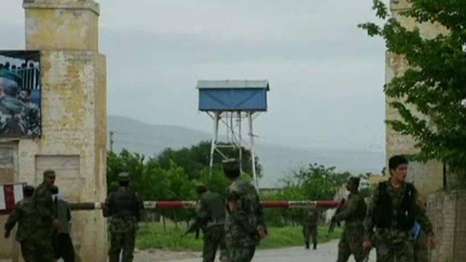 More than 100 feared dead after Afghan military base attack