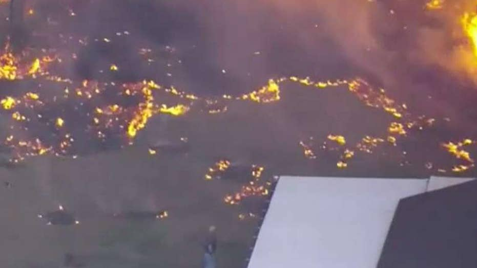Florida residents evacuate as 'suspicious' fire spreads
