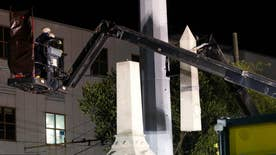 Removal of four Confederate monuments begins in New Orleans under cloak of darkness