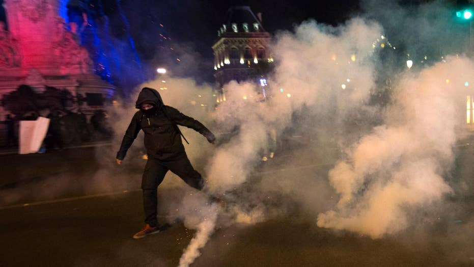 Protesters clash with police following French election