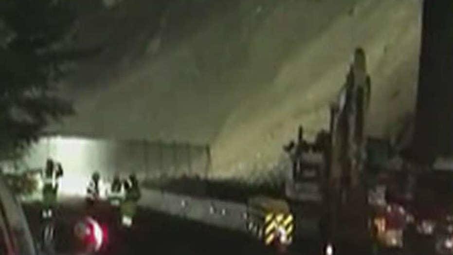 Road workers run from mudslide in California