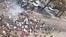 Raw video: At least 13 teens injured after driver barrels through group protesting on street