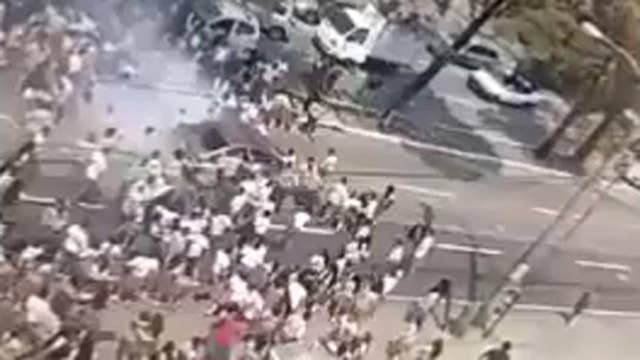 Car runs over crowd of student protesters in Guatemala