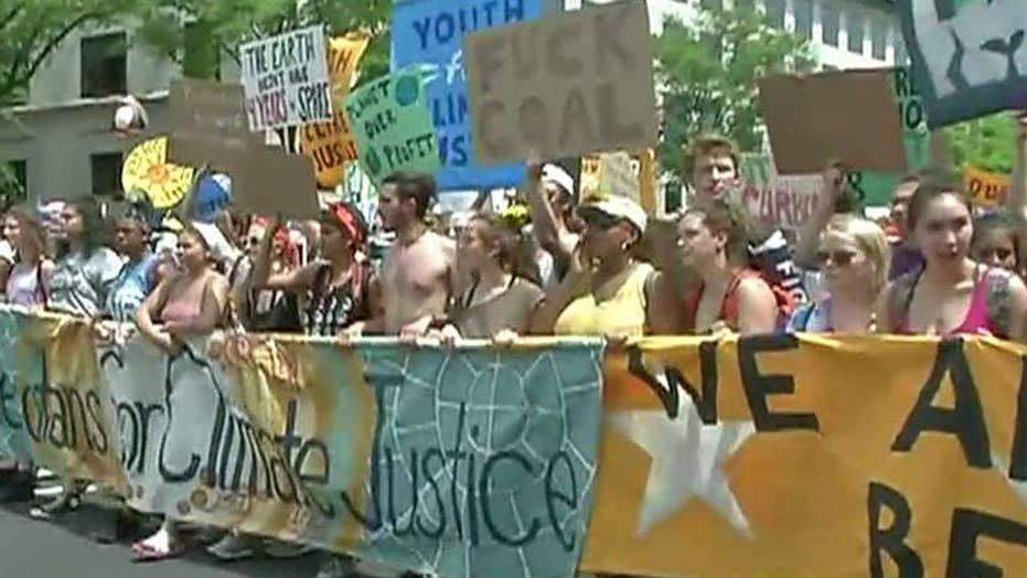Marchers protest President Trump's environmental policies