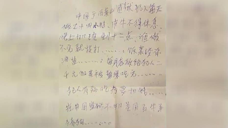 Woman finds note from Chinese prisoner in purse