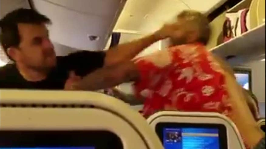 Caught on camera: A brawl between passengers on a flight from Japan