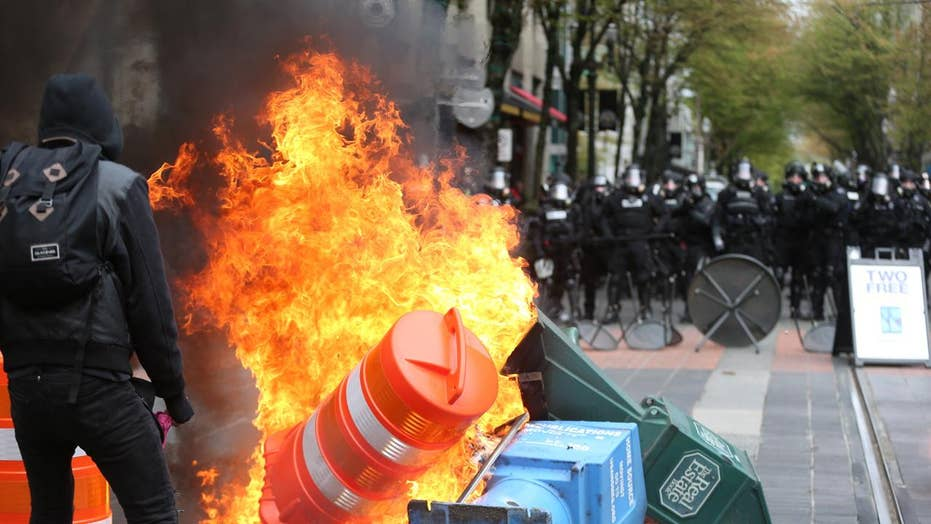 Anarchists clash with police during May Day protests