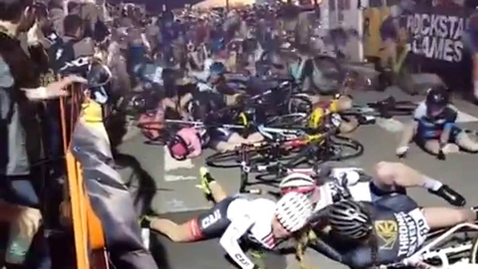 Massive pile-up caused by chain reaction crash in bike race