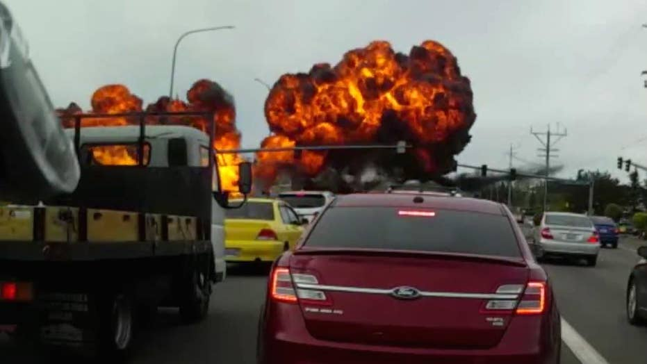Dashcam captures terrifying plane crash on busy road