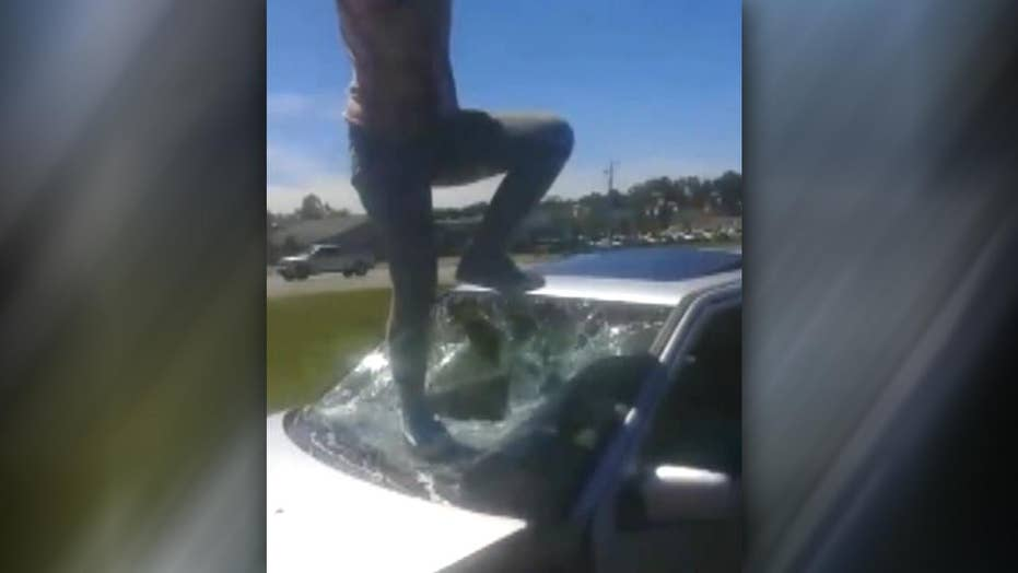 Woman completely stomps out car windshield