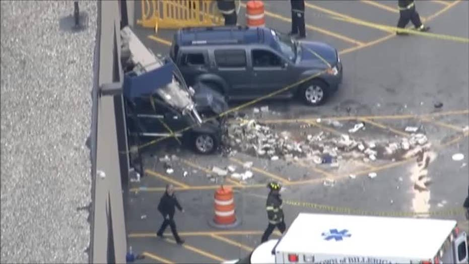 Car plows into crowd at Massachusetts auto auction