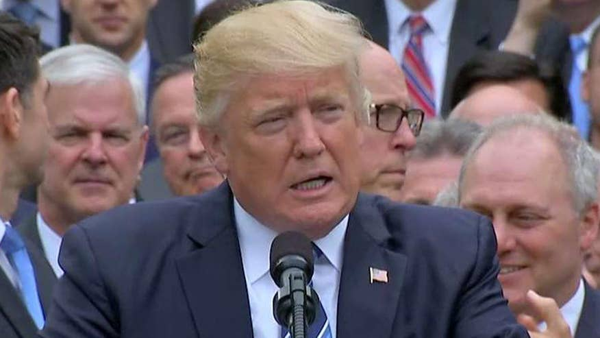 President, House Republicans take victory lap in White House Rose Garden following passage of health care bill
