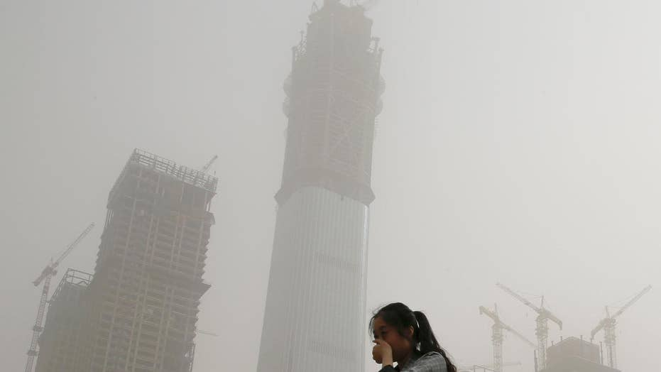 Sandstorm blankets China with dusty pollution