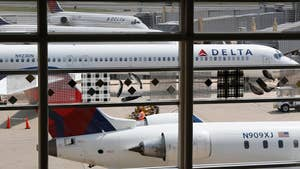 The airline is apologizing for forcing a family off a flight