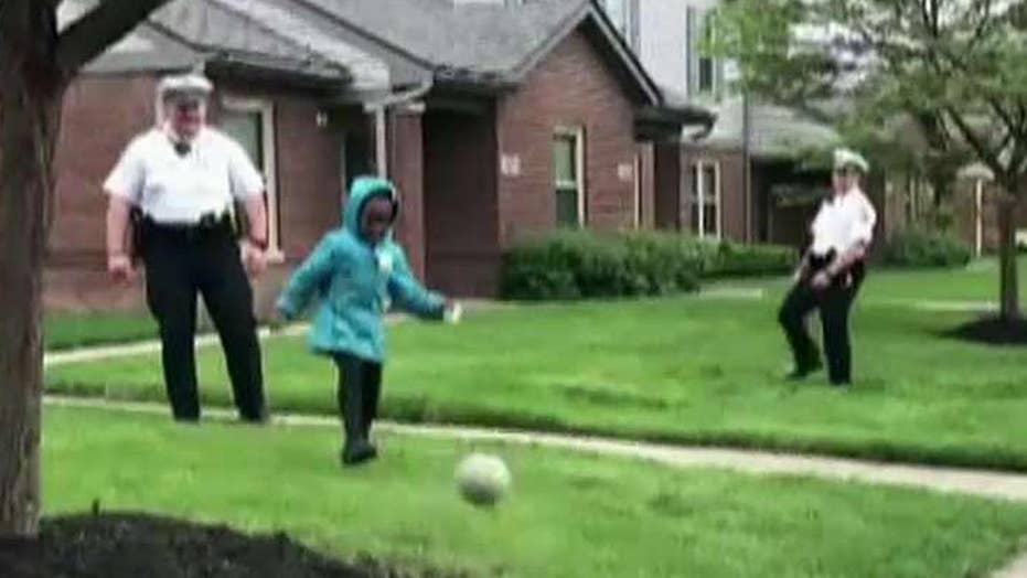 Cops take break from shooting probe to play soccer with kids