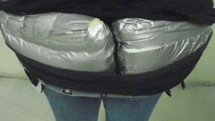 Packages of heroin found inside her pants