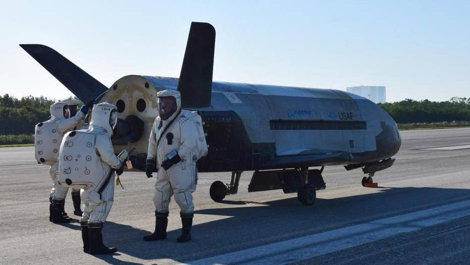 Secret US space plane lands after 2-year classified mission