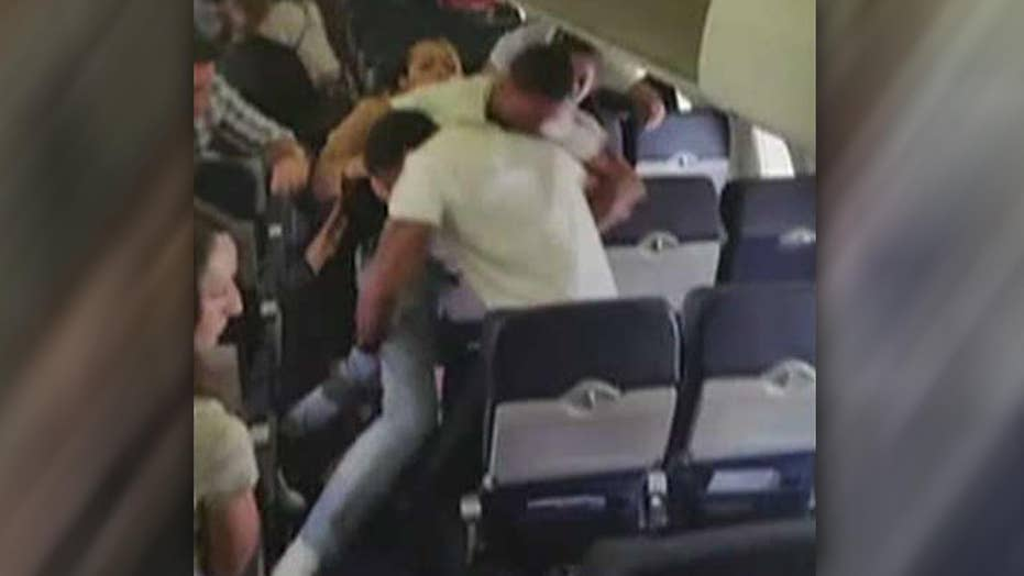 Passengers trade punches during violent brawl on plane