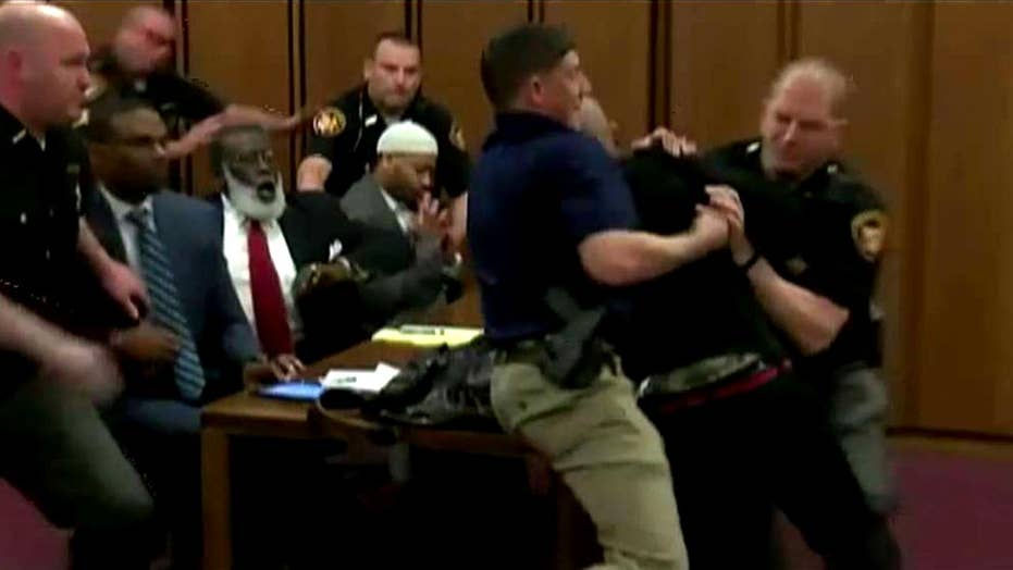 Family member of murder victim lunges at killer in court