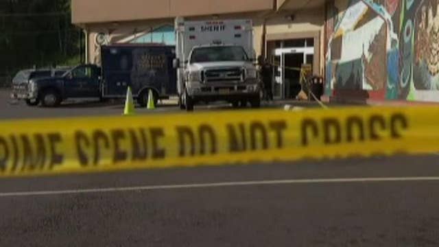 Man holding severed head stabs store employee