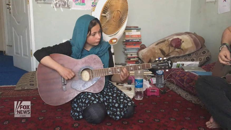 Mursal, a young Afghan suicide bomb survivor, finds healing through playing the guitar. Watch as she plays a tribute to slain U.S police officer Montrell Jackson