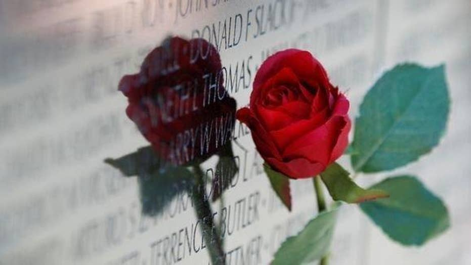 Foundation places roses on veterans' graves for Memorial Day