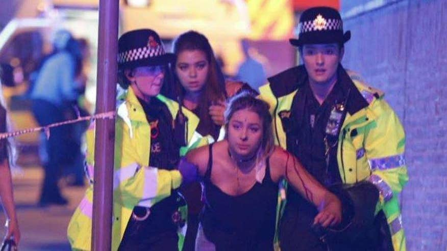 DailyMail.com reporter Jake Wallis Simons describes calm following chaos following explosion at Ariana Grande concert in Manchester that left at least 19 dead, 50 injured. There was no terror alert or elevated terror levels before the blast