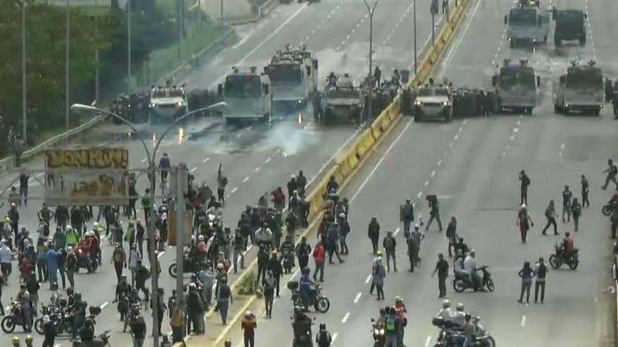 Protesters block highway, clash with police