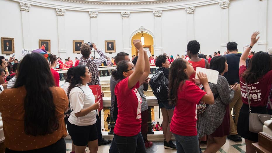 Texas House halted by protests, scuffle between lawmakers