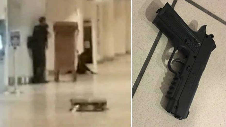 Man with fake gun surrenders after Orlando airport standoff