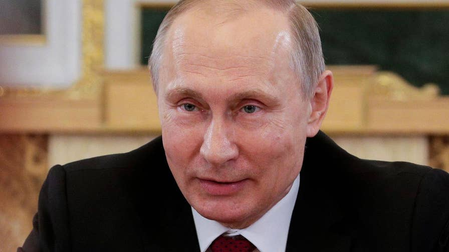 But the Russian president concedes that individual Russian 'patriots' may try hacking U.S.; Amy Kellogg reports from Milan, Italy