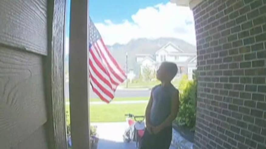 A Utah mom caught her seven-year-old son on security footage pledging his allegiance to the American flag all on his own