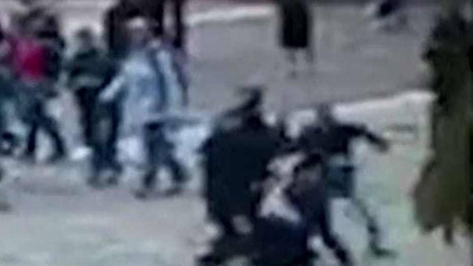 Paris hammer attack caught on surveillance video