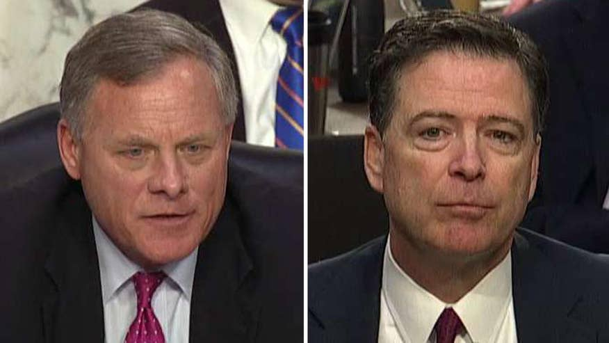 Former director of the FBI responds to questions from Sen. Richard Burr, chairman of the Senate Intelligence Committee