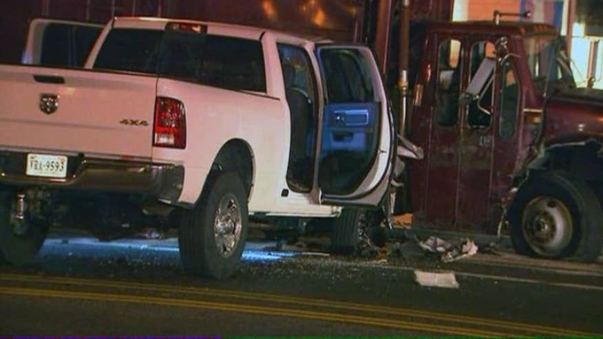 Two police officers, transportation worker injured after pickup truck rammed into them
