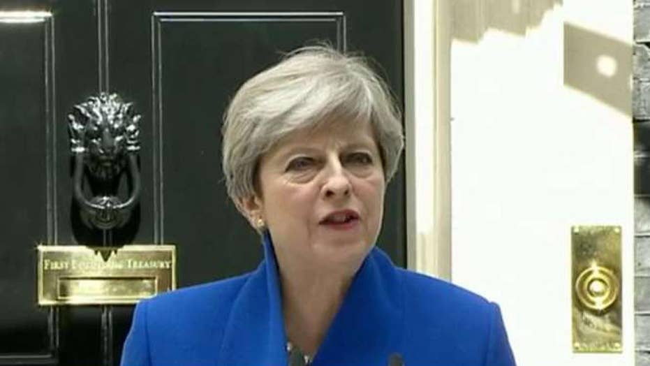 May vows not to resign after her historic miscalculation