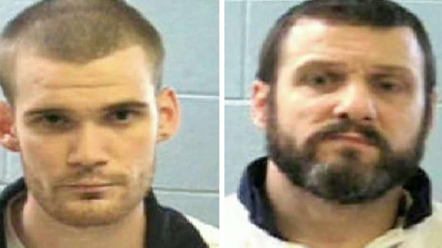 Inmates killed guards with their own guns, escaped in car-jacked vehicle