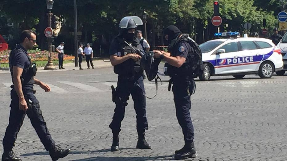 French officials: Paris attacker badly burned, died at scene