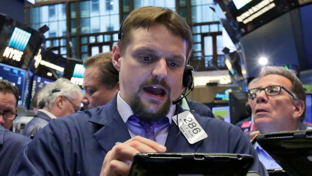 Dow rises more than 100 points, hits record high