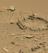 UFO hunters claim to have discovered what looks like a 'stone circle' on the surface of Mars. The image was captured by the NASA's Mars Curiosity rover