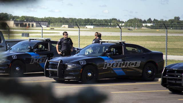 Suspect in custody after officer stabbed at Flint airport
