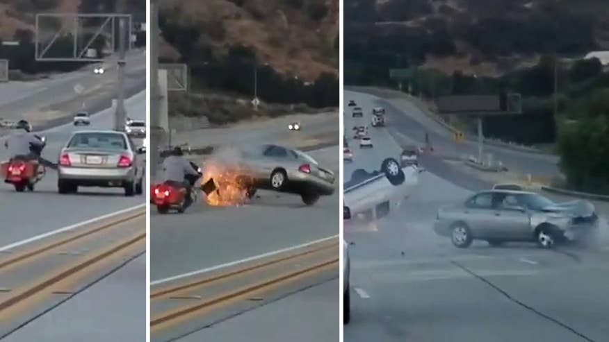 Raw video: Driver on California highway records scary crash on cell phone when altercation between motorcycle and car seems to escalate