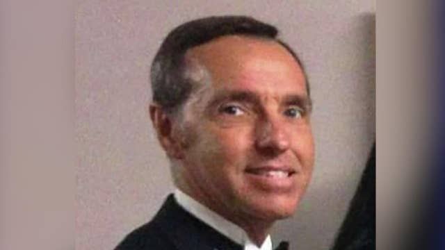 Vet charged with selling top secret documents to China