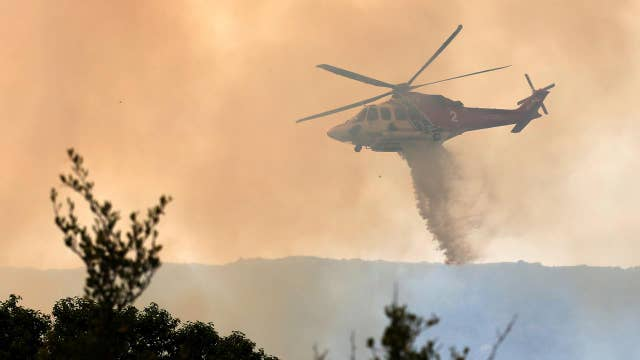 High temperatures, winds complicate Western wildfire fight