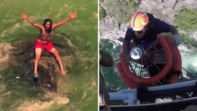 Chopper plucks stranded swimmer in dramatic rescue